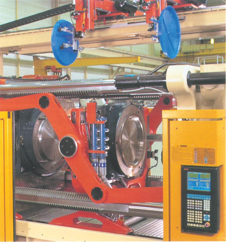 Husky sprøjtestøbemaskine monteret med etagelukkeenhed